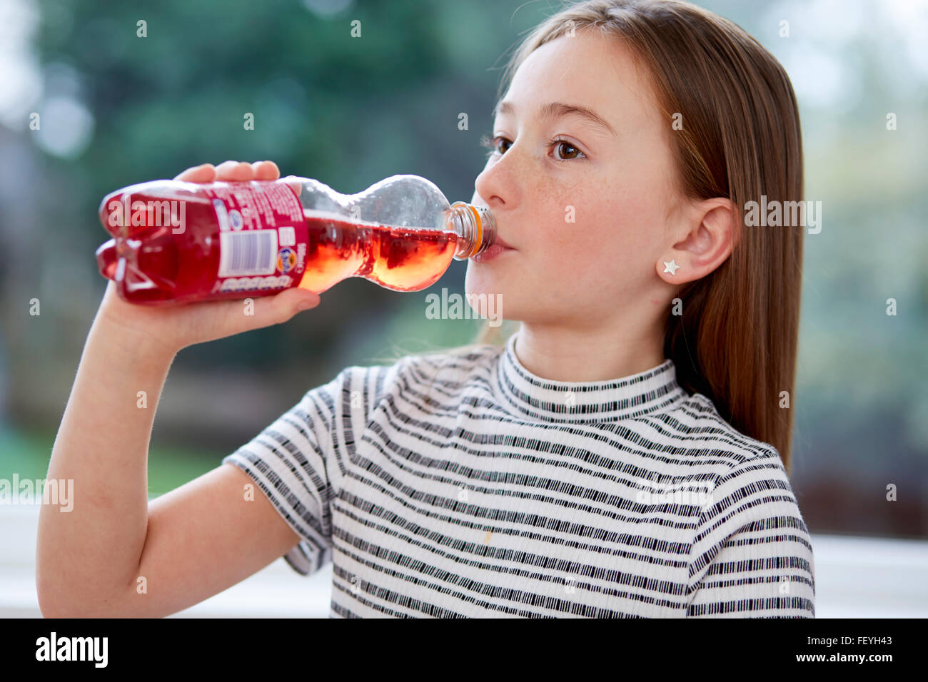 Young girl drinking fizzy drink - Stock Image
