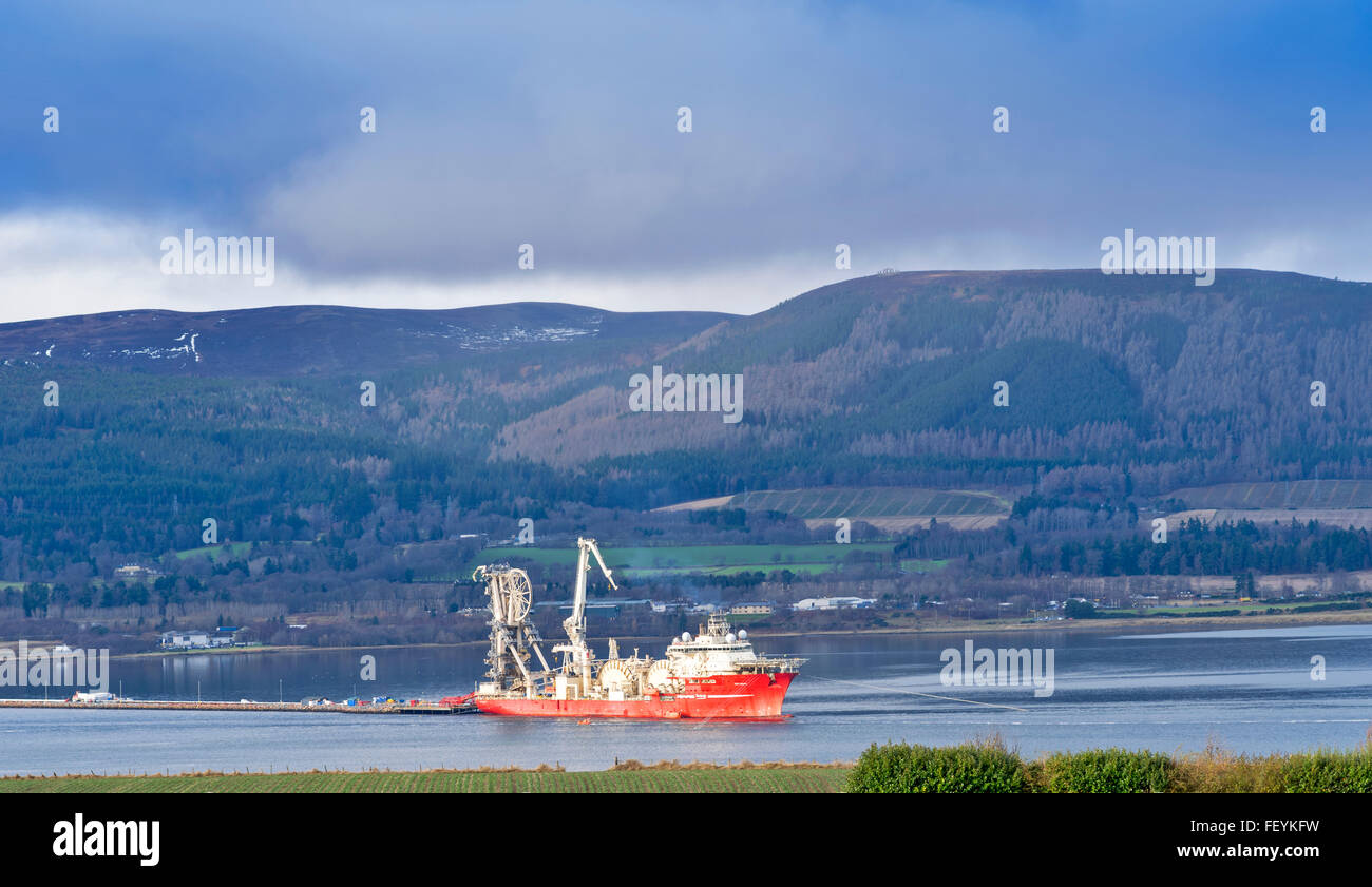 NORTH SEA OIL CABLE SHIP DEEP ENERGY ANCHORED IN THE CROMARTY FIRTH OFF INVERGORDON SCOTLAND - Stock Image