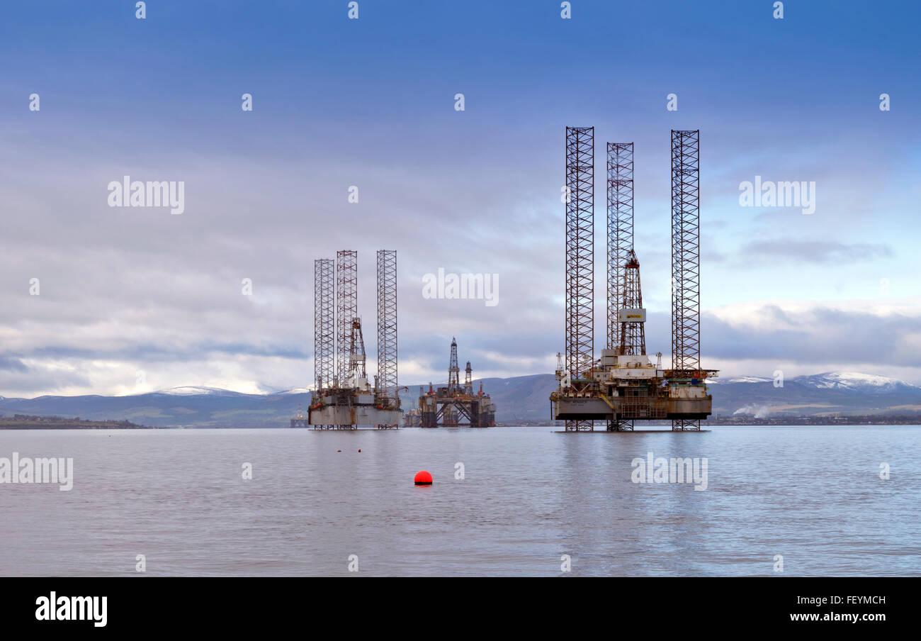 NORTH SEA OIL RIGS MONARCH AND GALAXY  ANCHORED OUTSIDE CROMARTY THE BLACK ISLE CROMARTY FIRTH WITH SNOW ON THE - Stock Image
