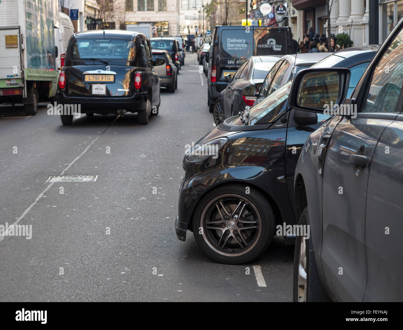 A small car parked sideways - Stock Image