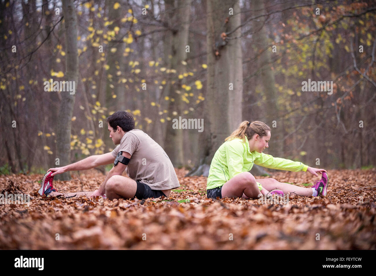 At the end of the penultimate day of the event, two runners stretch off near Brussels in Belgium. A group of Soldiers - Stock Image