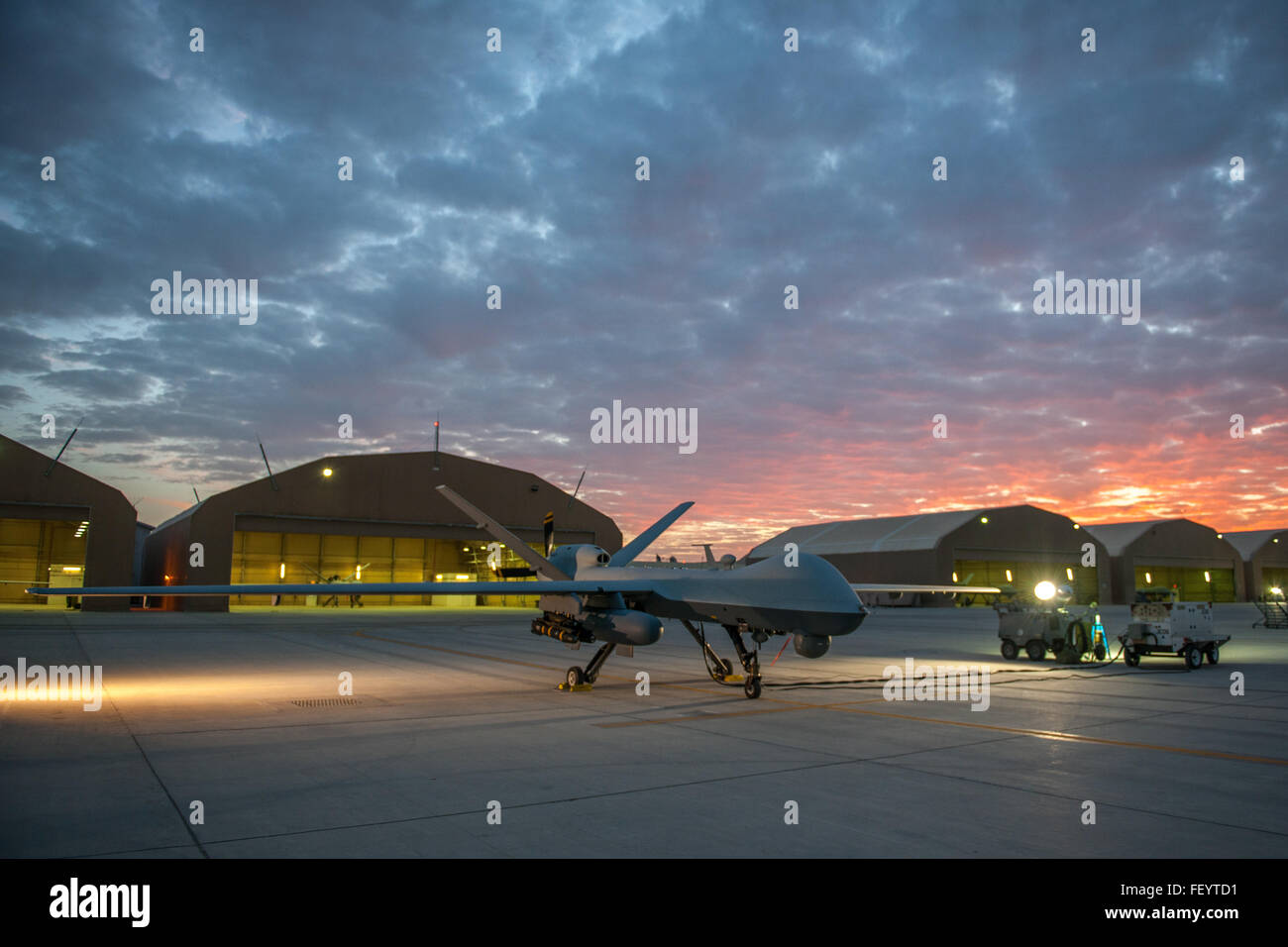 An MQ-9 Reaper equipped with an extended range modification from the 62nd Expeditionary Reconnaissance Squadron - Stock Image