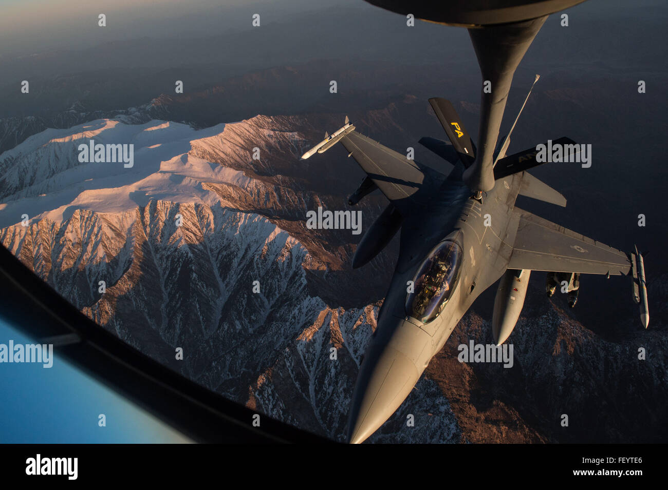 A U.S. Air Force KC-135 Stratotanker refuels a U.S. Air Force F-16 Fighting Falcon over Afghanistan in support of - Stock Image