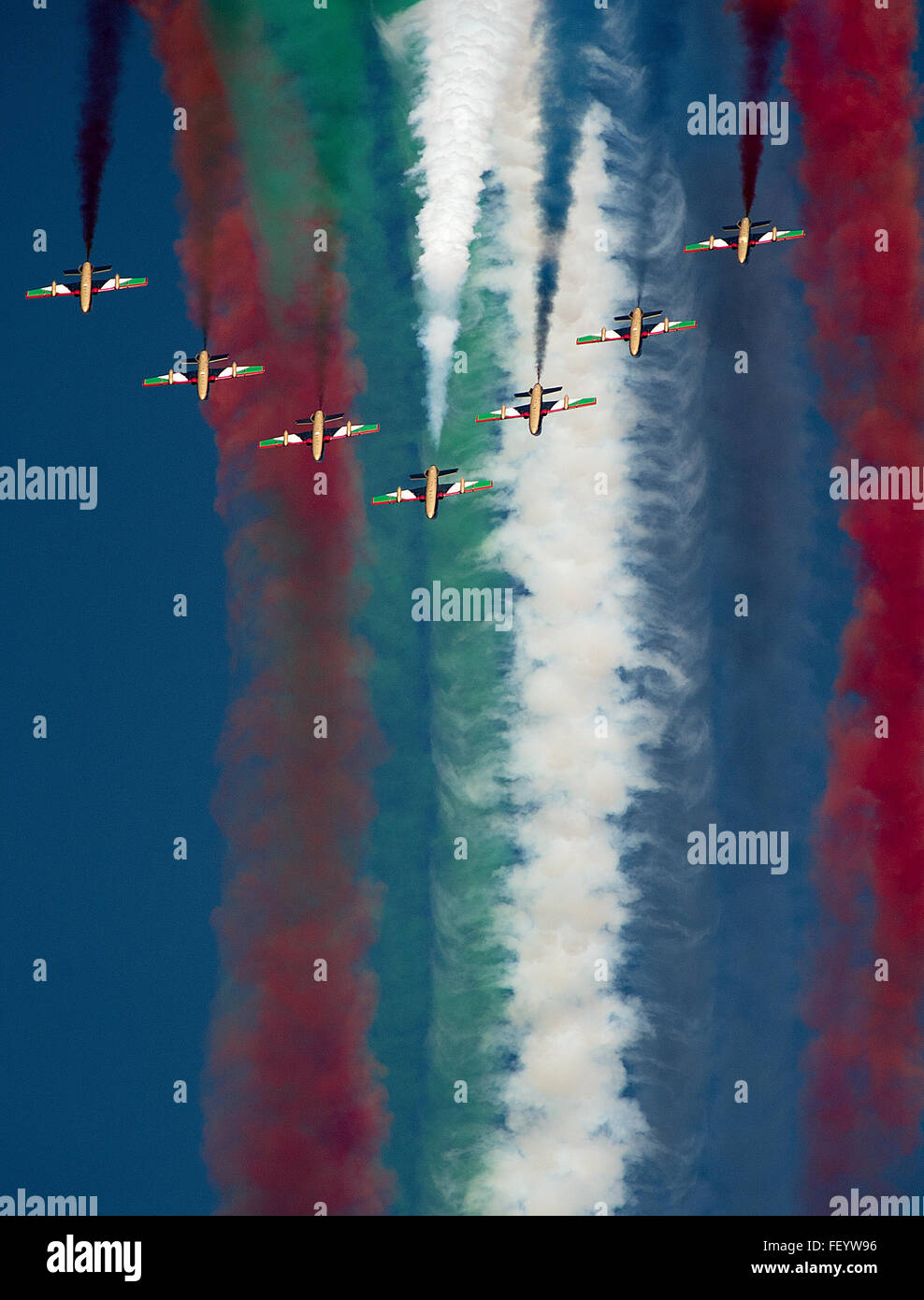 """Al Fursan"" (The Knights), the United Arab Emirates Air Force aerobatic display team, flies in formation during - Stock Image"