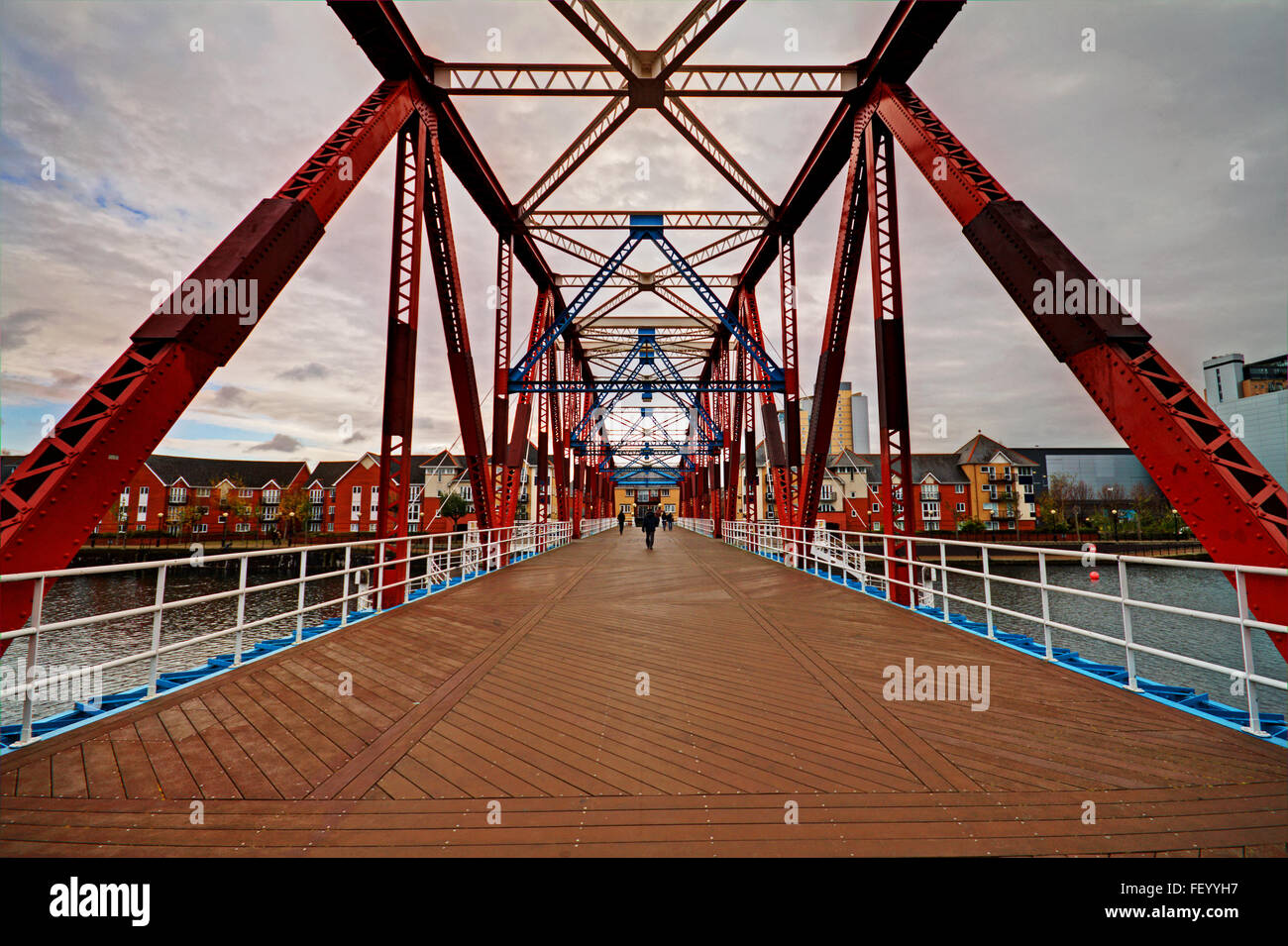 Crossing the rotating former railway bridge at Salford Quays, Manchester - Stock Image