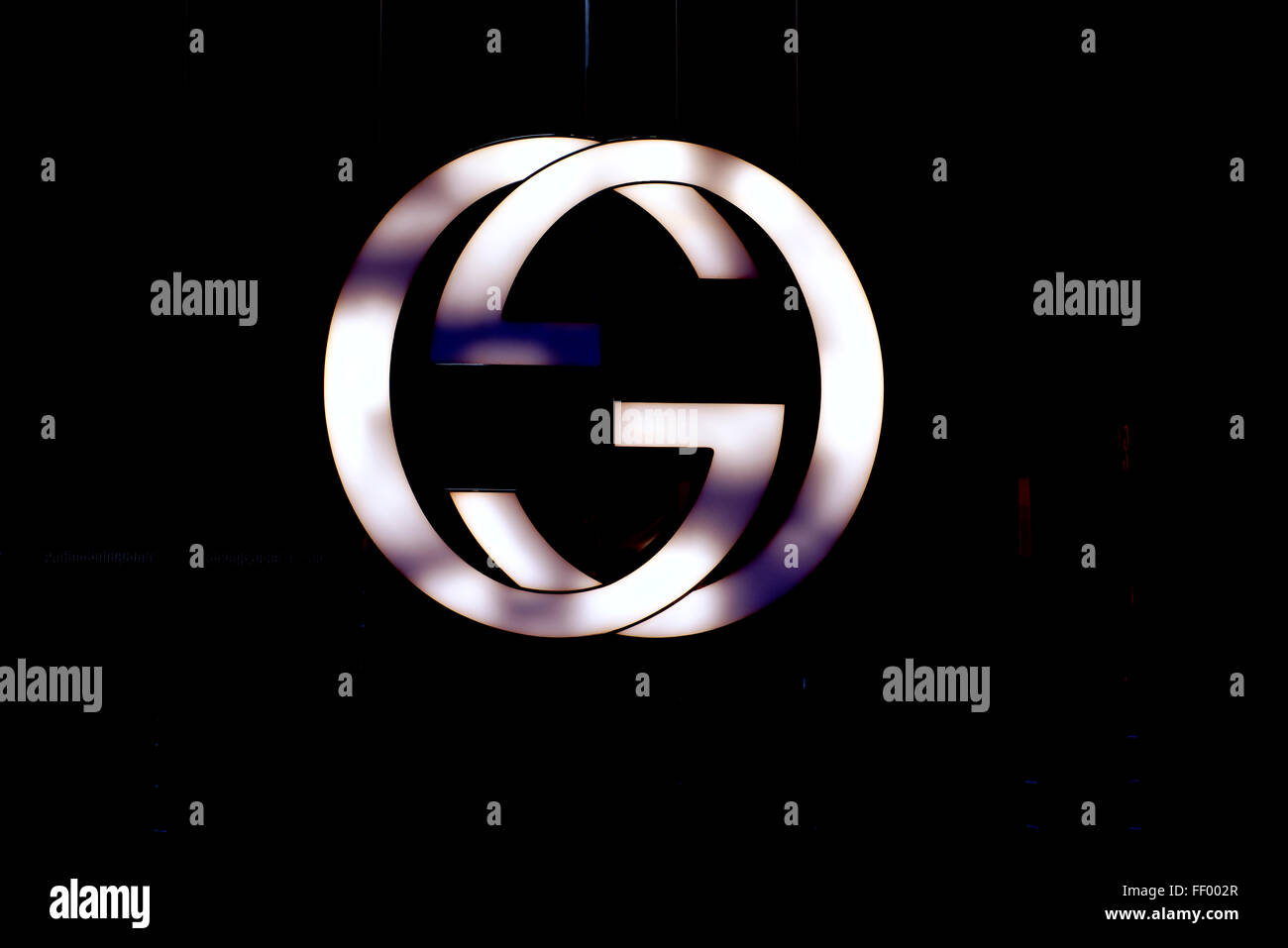 Illuminated Gucci Logo On The Central Hong Kong Store Stock Photo