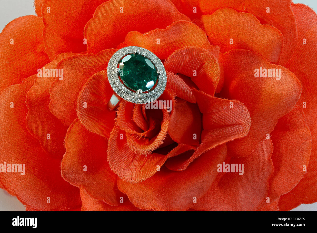 Emerald ring with diamonds - Stock Image