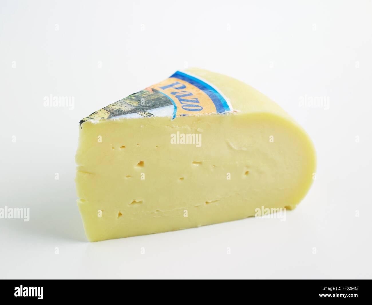 Slice of Spanish Arzua-Ulloa DOP cow's milk cheese - Stock Image