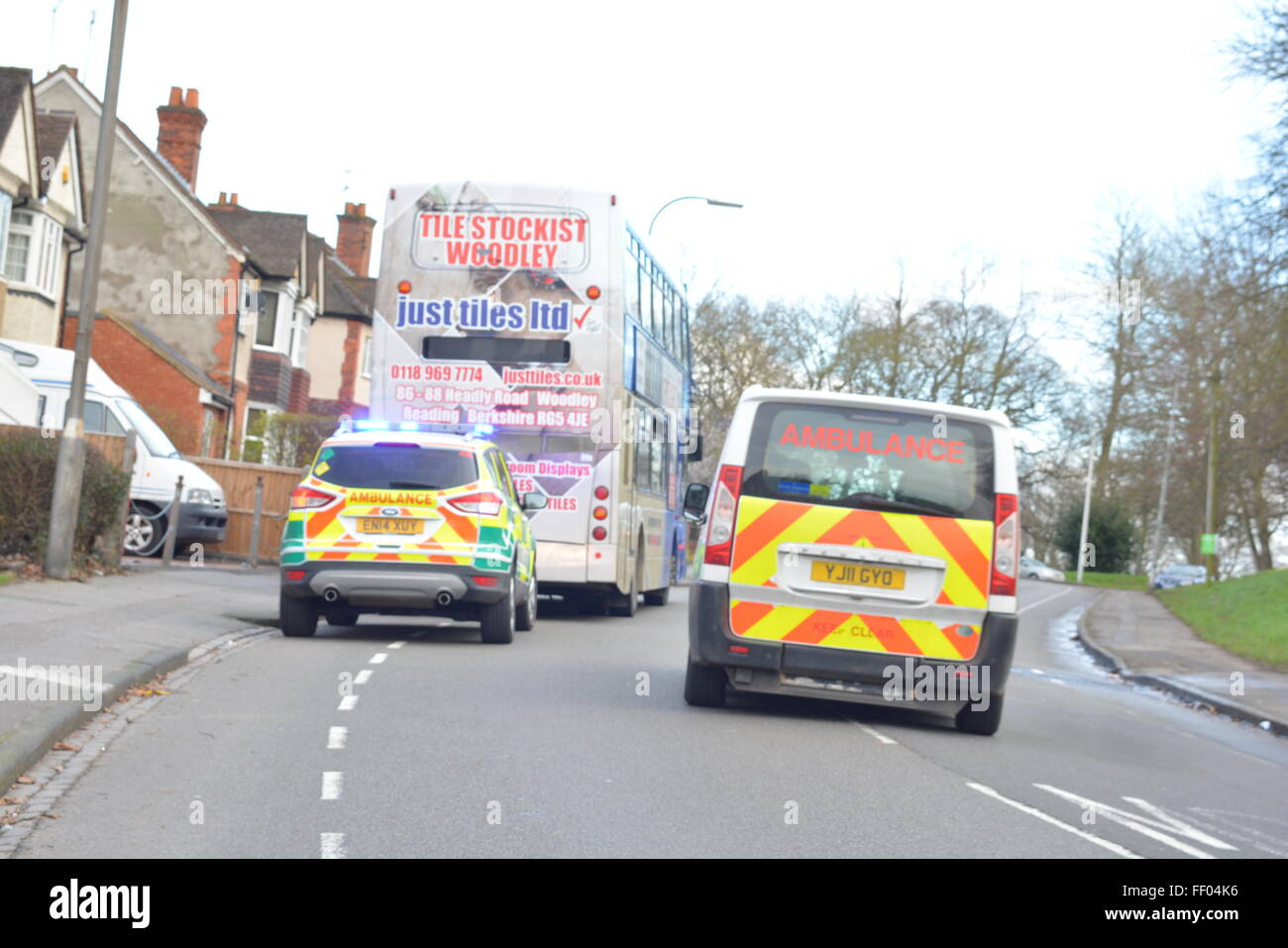 Woman suffers head injury in Tilehurst Road, Reading, Berkshire after bus collides with car. Charles Dye / Alamy Stock Photo