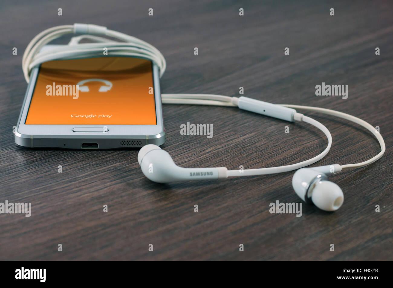 Smartphone with Earbuds Smartphone with Earbuds - Stock Image