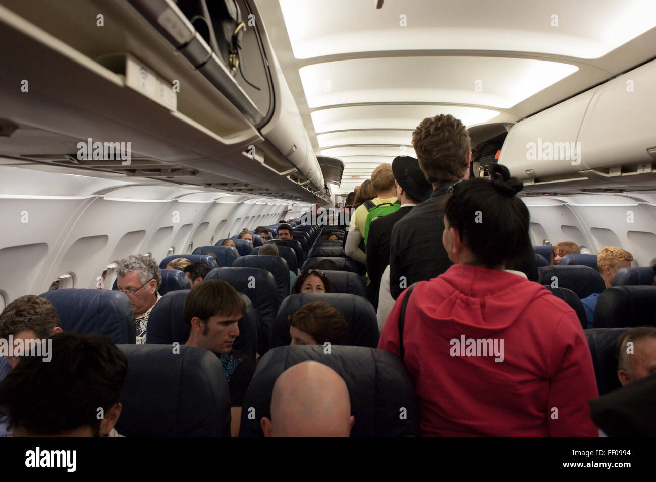 Passengers Boarding Airplane Passengers Boarding Airplane - Stock Image