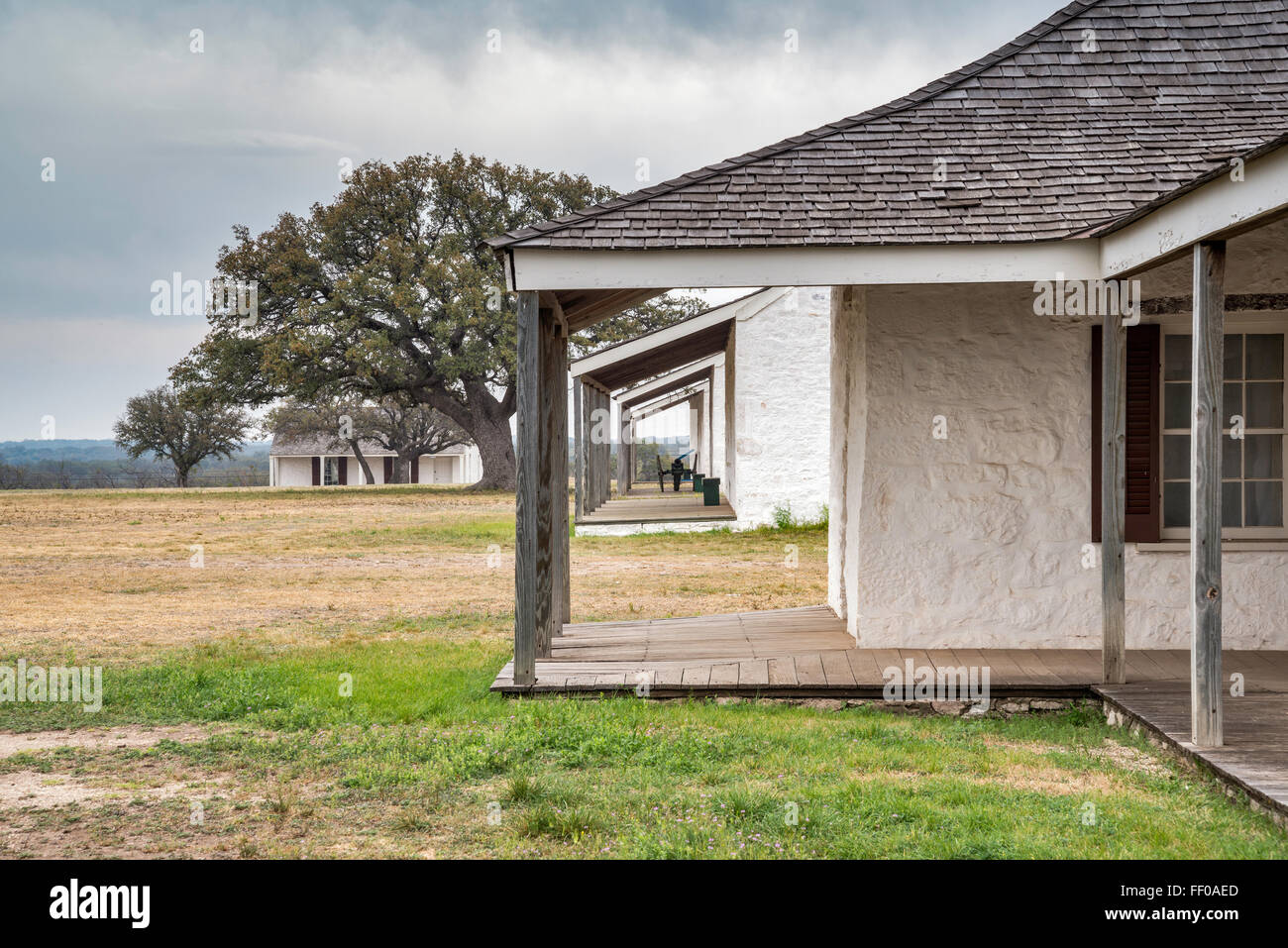 Lieutenants Row reconstructed buildings at Fort McKavett State Historic Site in Fort McKavett, Texas, USA - Stock Image