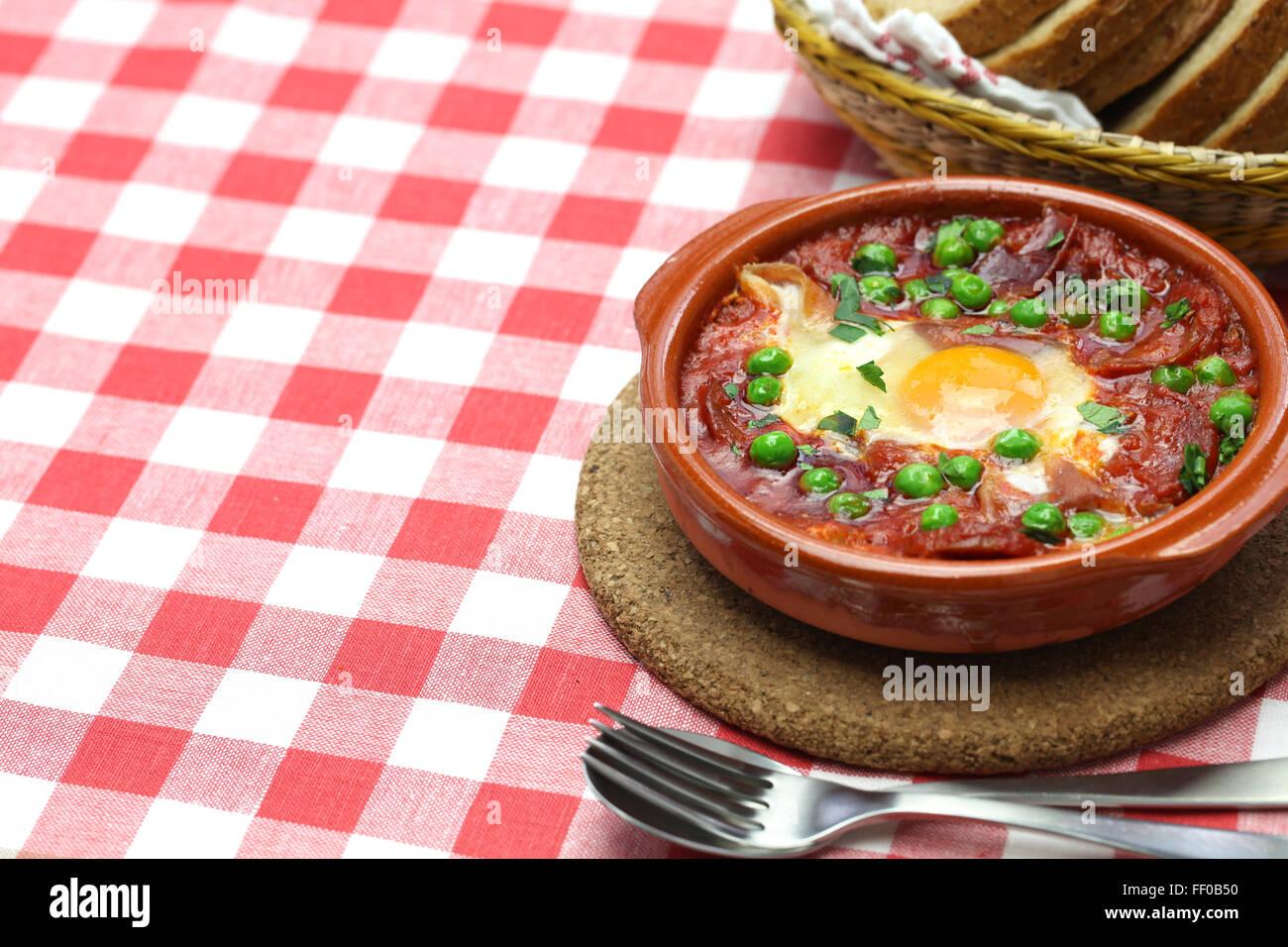 flamenco eggs, huevos a la flamenca, spanish andalusian cuisine - Stock Image