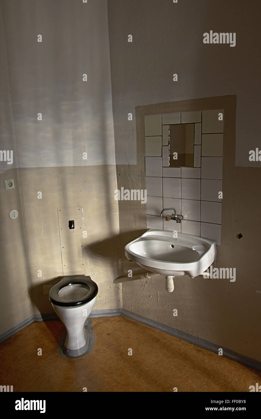 toilet and washbasin inside a cell in a stasi prison - Stock Image