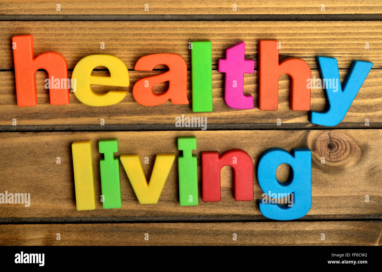 Healthy living word on wooden table - Stock Image