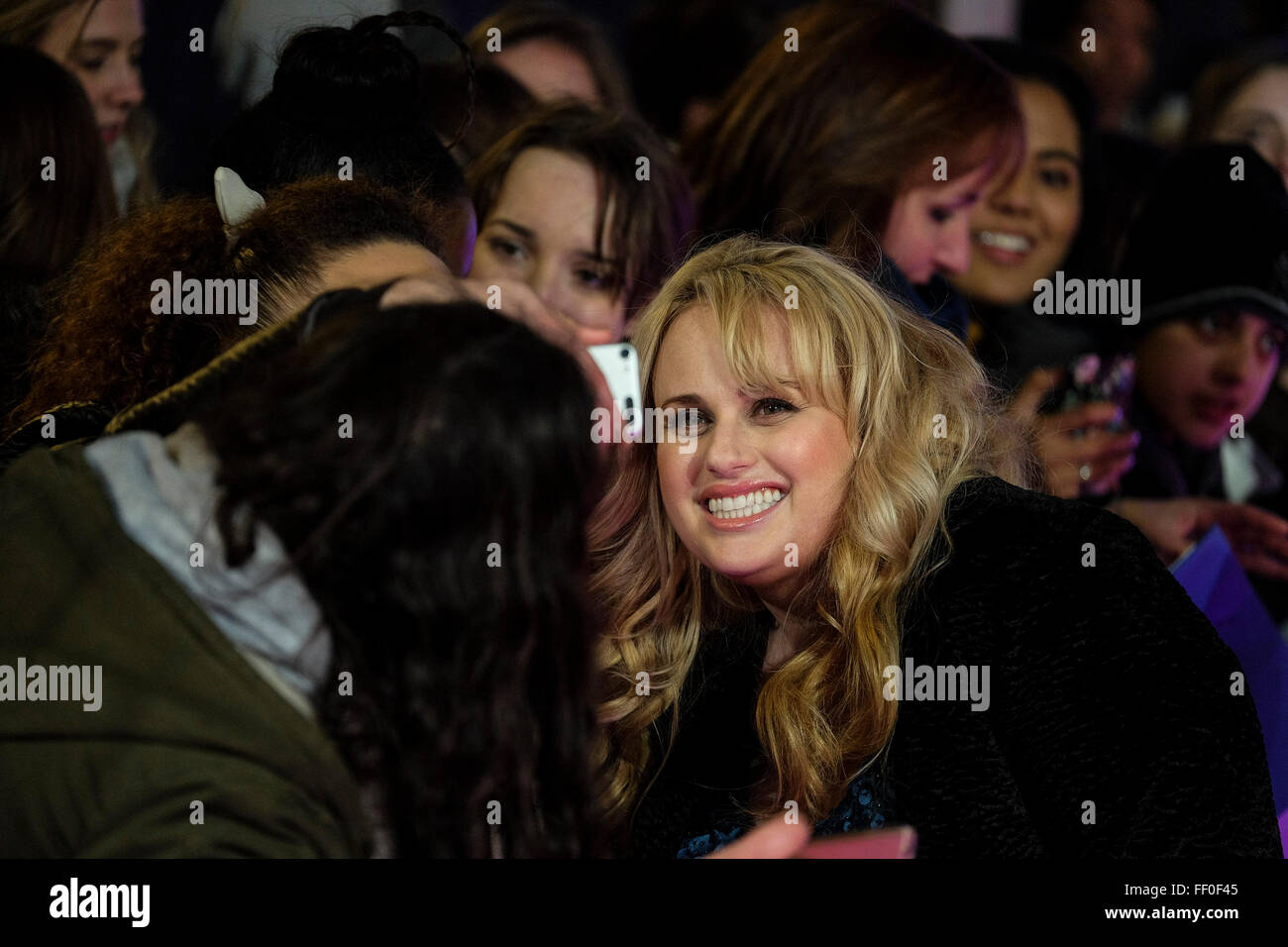 """Rebel Wilson arrives on the red carpet for the European Premiere of """"How To Be Single"""" on 09/02/2016 at The VUE Stock Photo"""