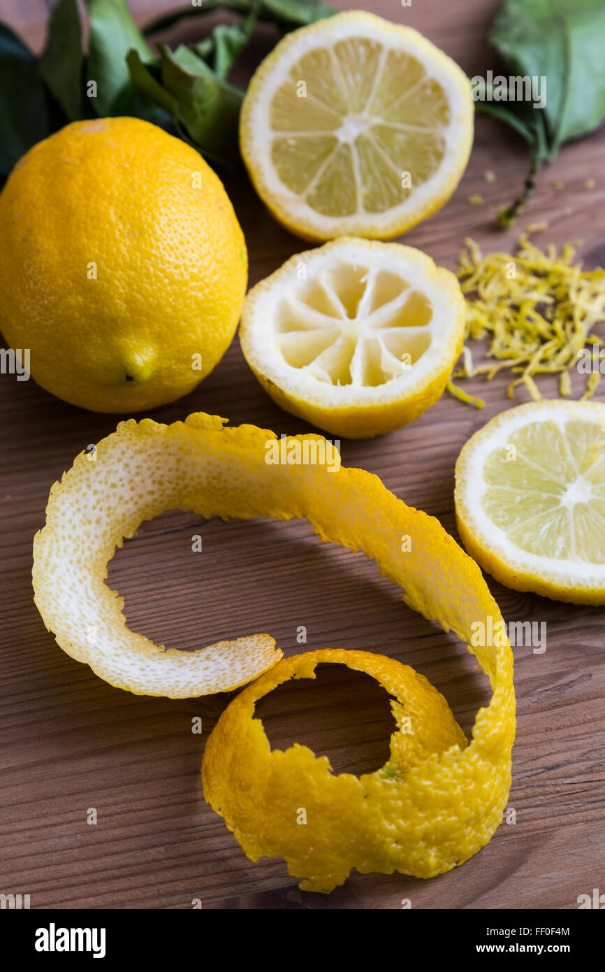 Lemon slices with peel, zest and leaves - Stock Image