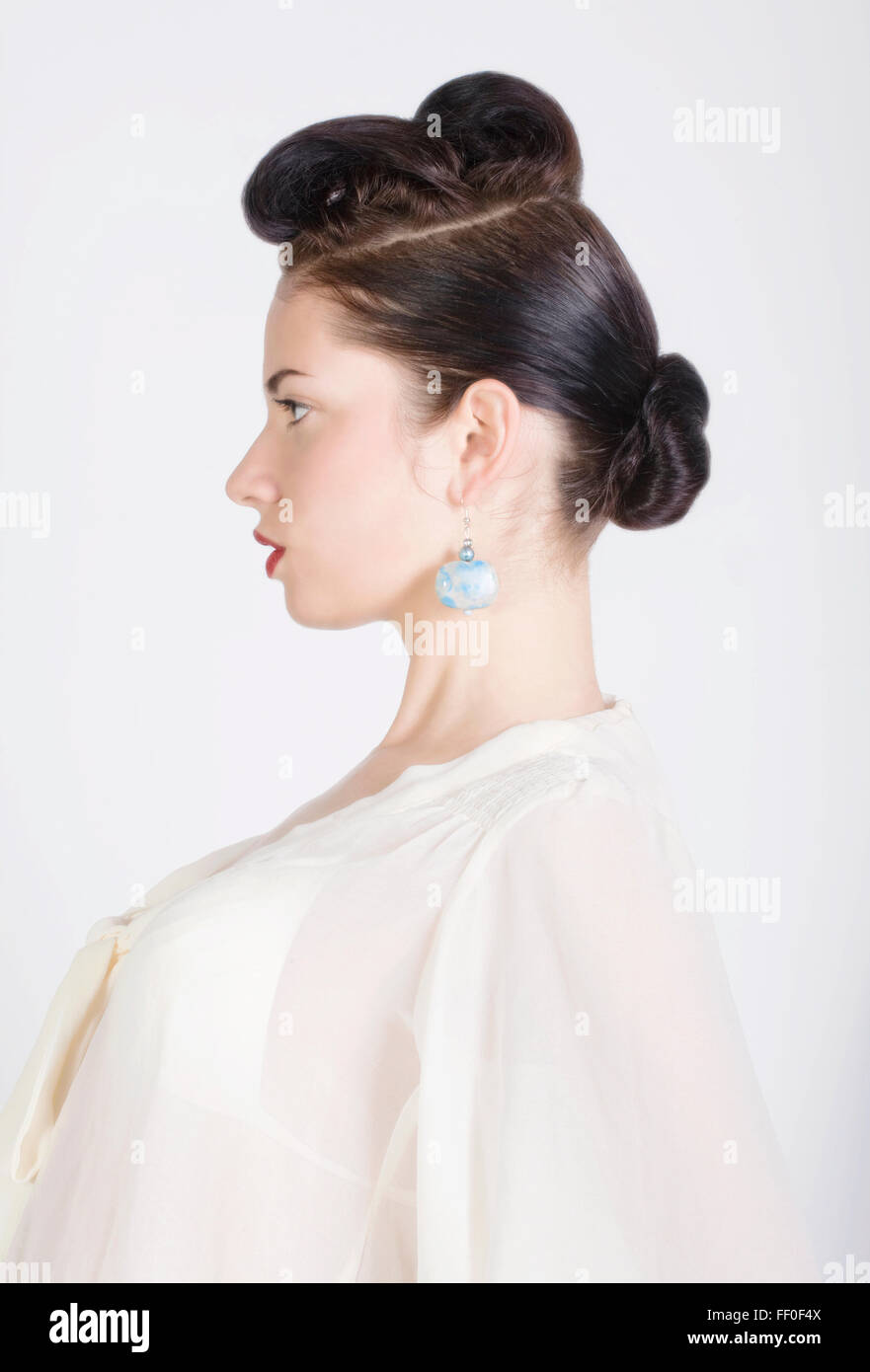 Beauty portrait of profile of a young beautiful woman with a chignon - Stock Image