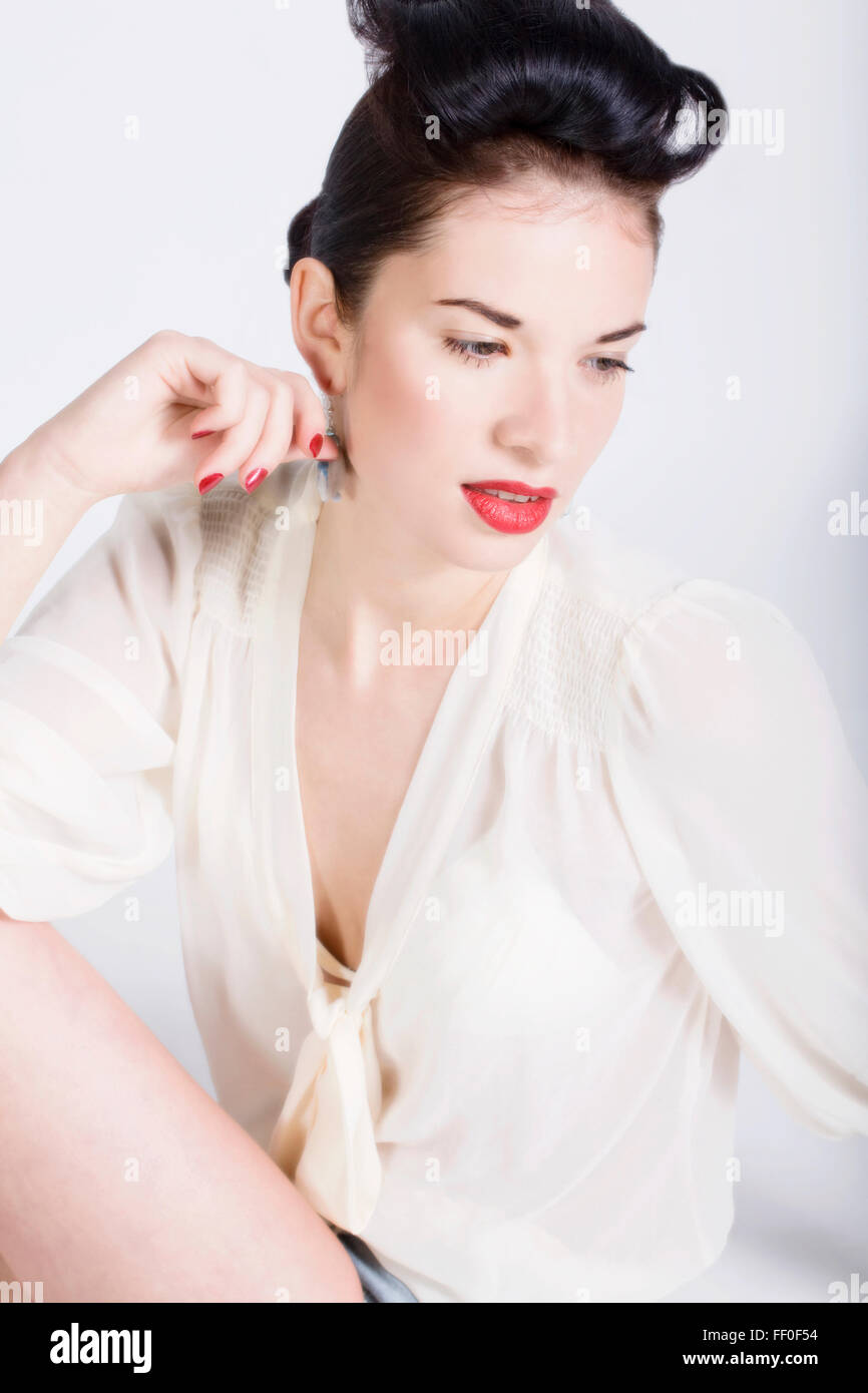 Portrait of a young beautiful woman wearing red lipstick. Fashion photography - Stock Image
