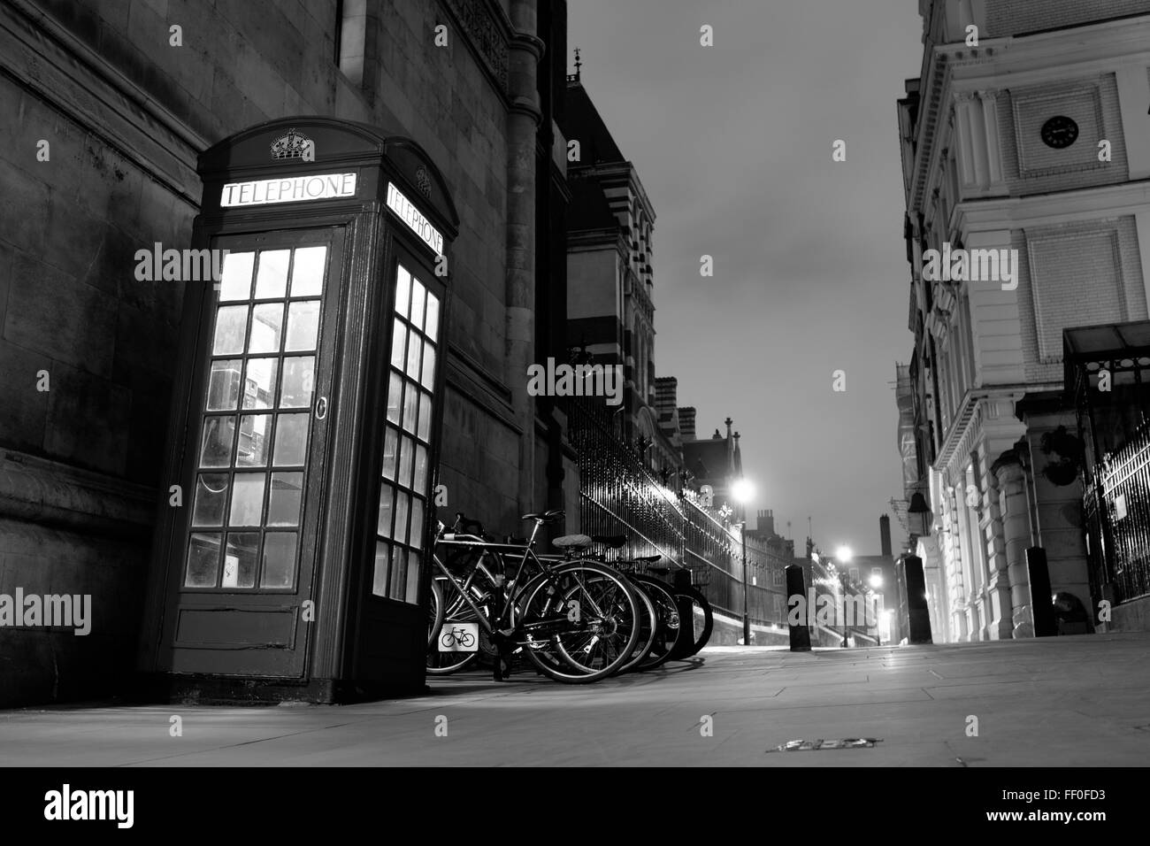 A lonely phone box booth in London sits quietly during this beautiful night scene. - Stock Image