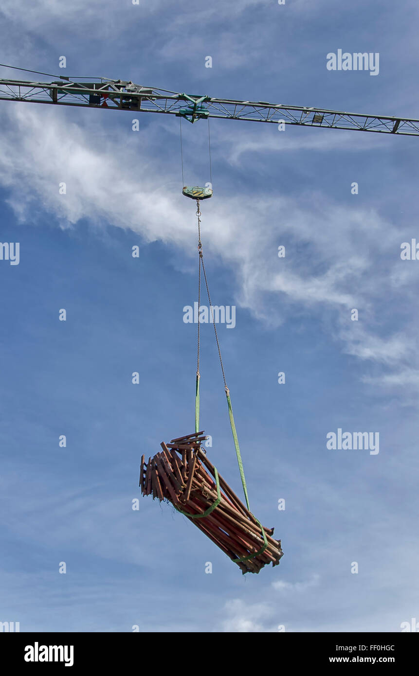 Load of acrow props moved by crane - Stock Image