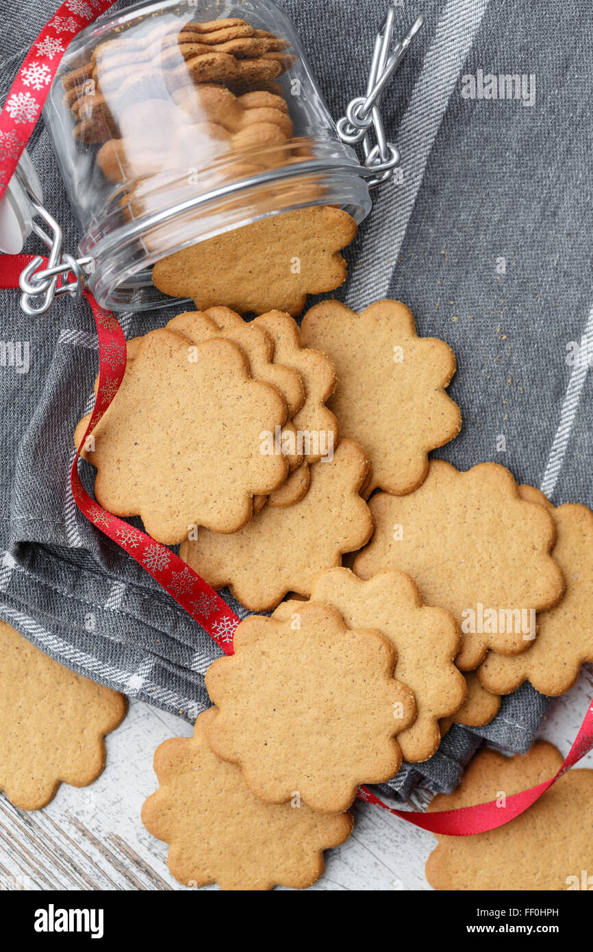 Pepparkakor (Swedish Ginger Cookies) spilling from a jar - Stock Image