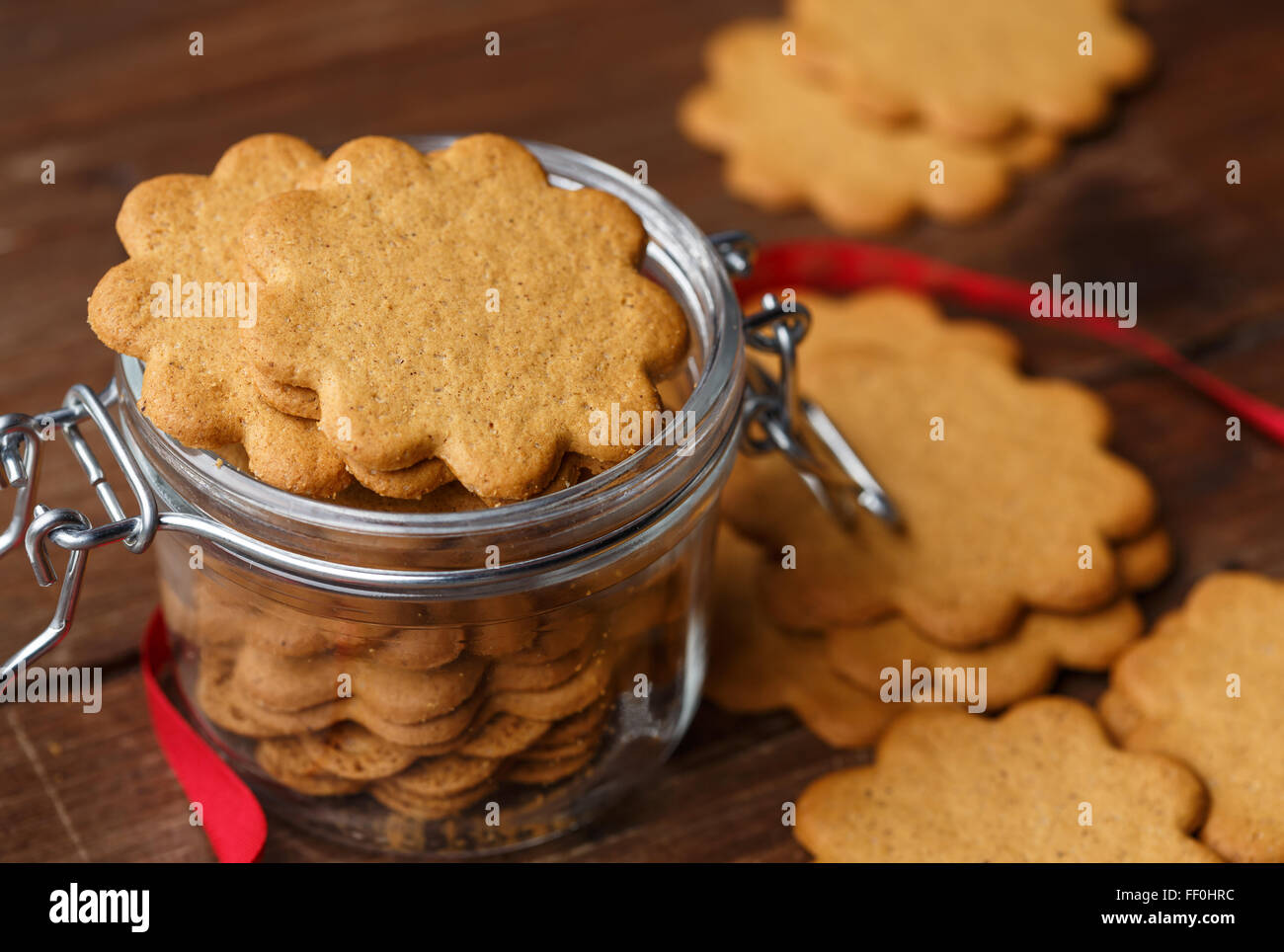 Pepparkakor (Swedish Ginger Cookies) in a glass jar - Stock Image
