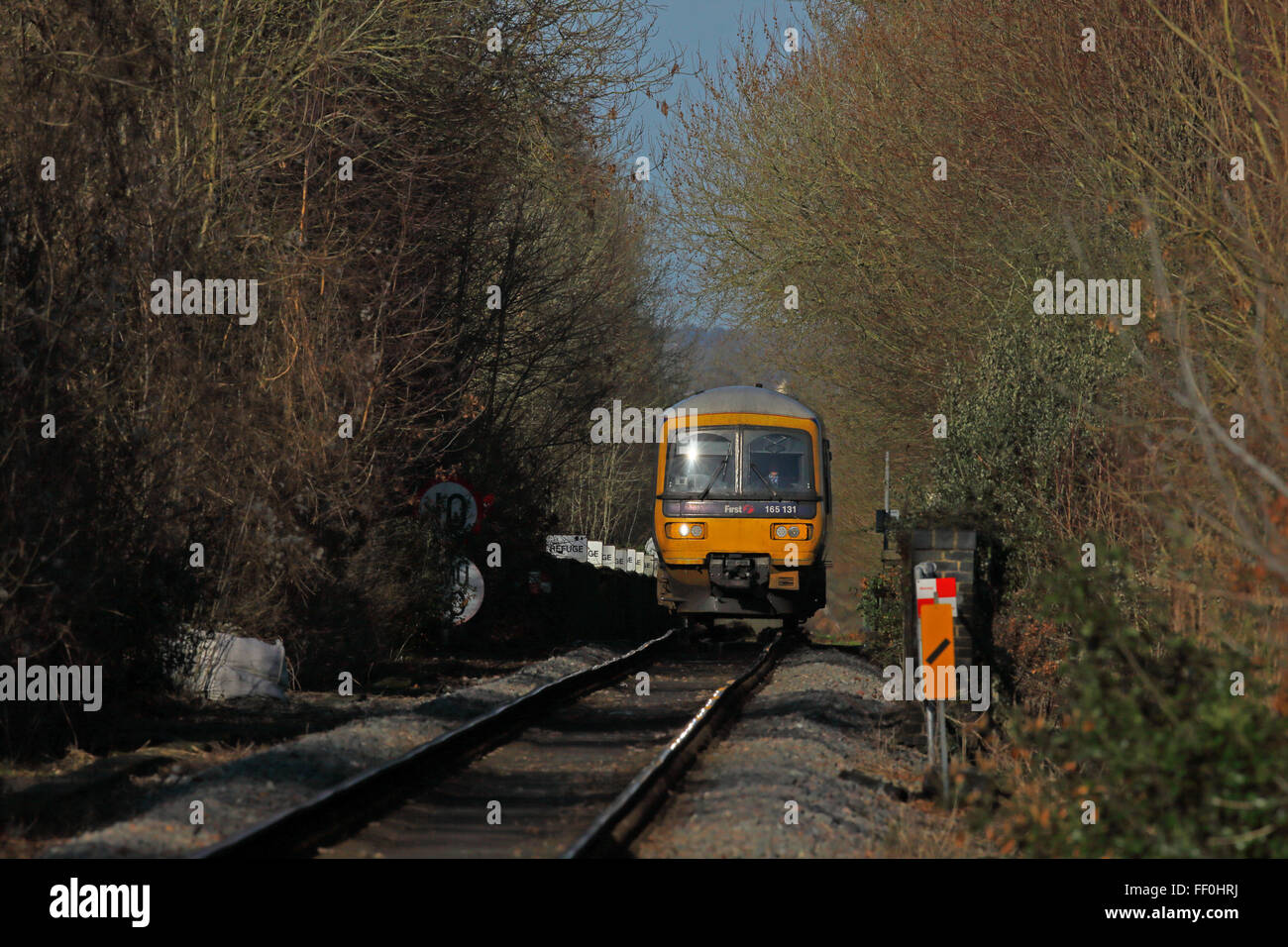 A slowly approaching class 165 Diesel Multiple unit crossing Shiplake Viaduct over the Thames at Shiplake. - Stock Image