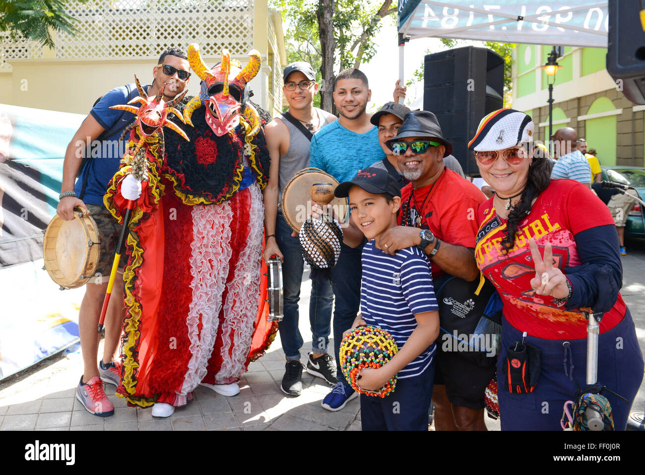 Traditional Masked Cultural Figure VEJIGANTE Posing With People During Carnival Ponce Puerto Rico February 2016