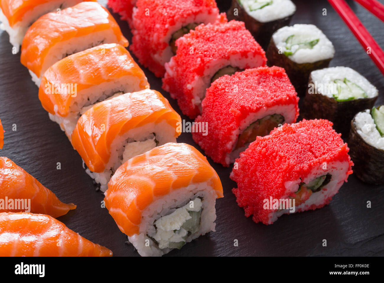 set of sushi and rolls on a slate table. - Stock Image