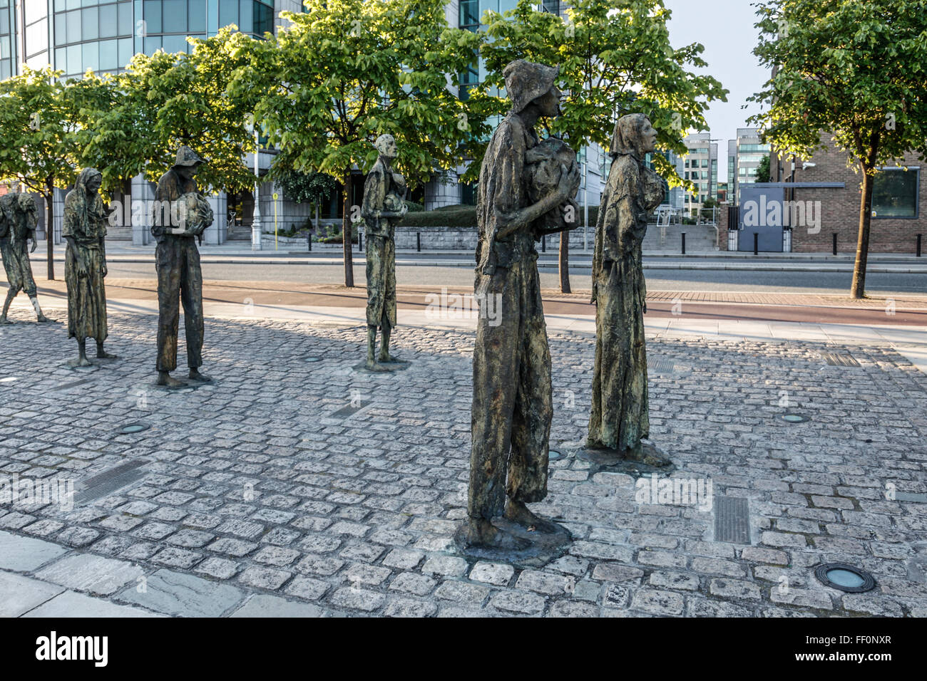Part of the 'Famine' sculpture monument by Rowan Gillespie, on Custom House Quay in Dublin, remembering - Stock Image