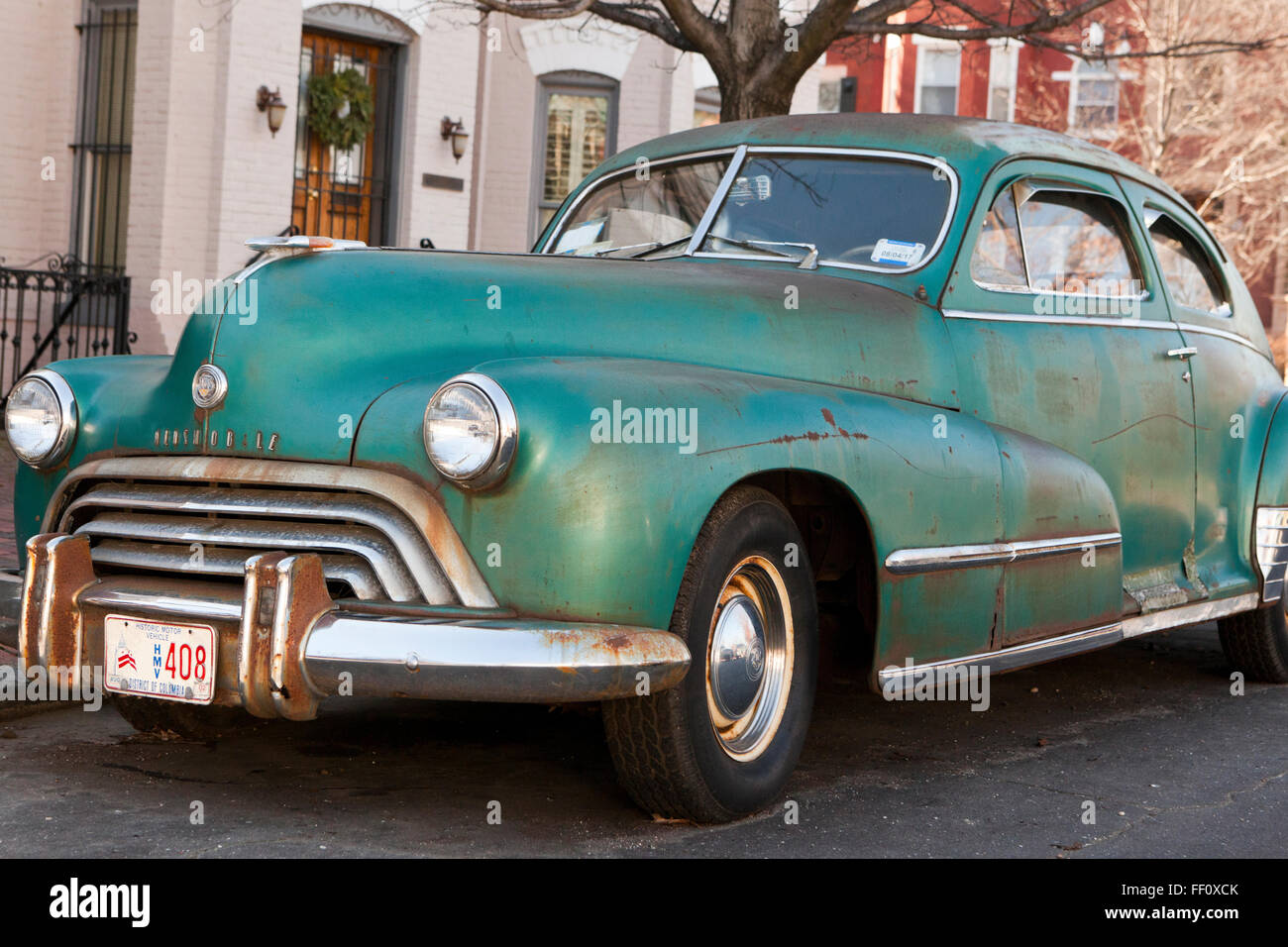Vintage 1948 Oldsmobile Coupe 66 2-door car (rusty old car) - USA - Stock Image