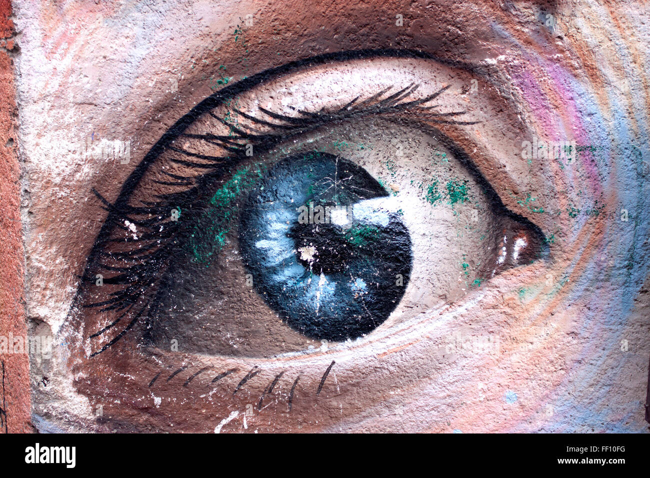 A painting of an eye decorates a wall in a street of Baeza, Jaen, Andalusia, Spain - Stock Image