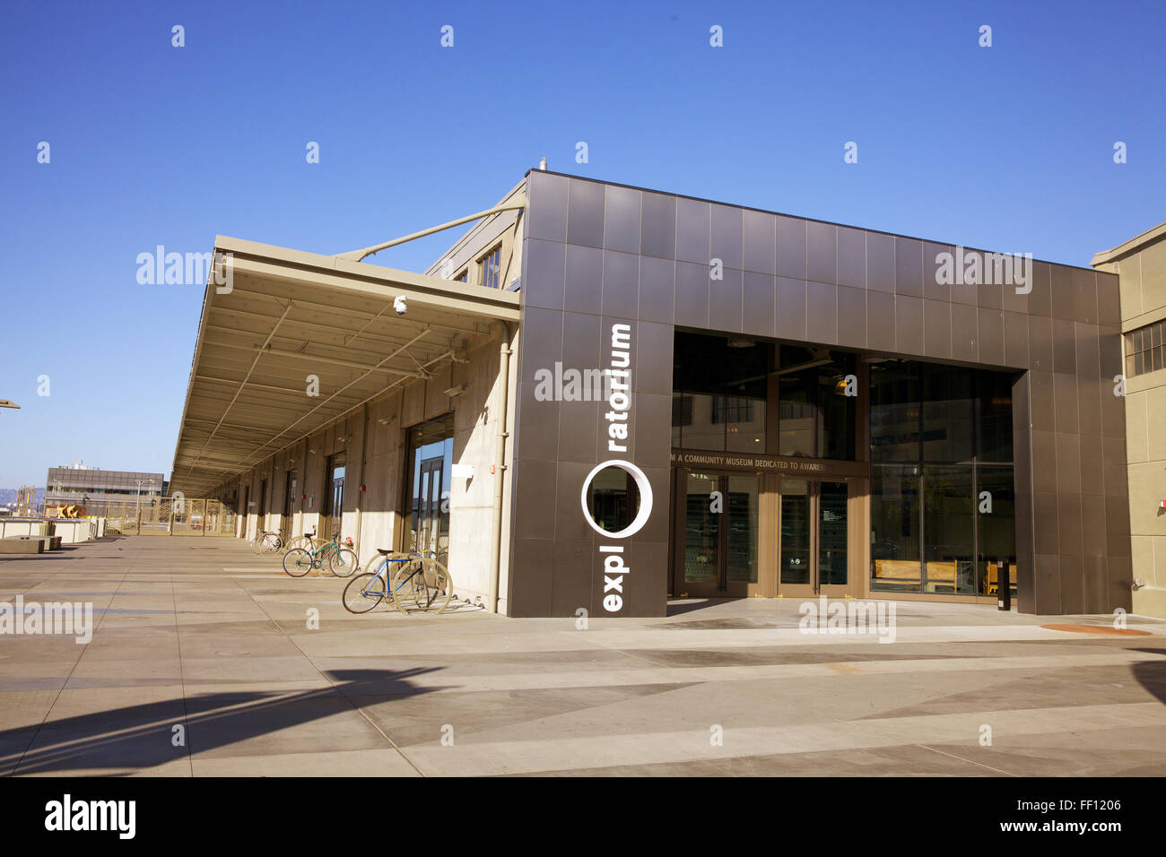 The entrance of the Exploratorium with clear blue skies in the background located on San Francisco's Embarcadero. - Stock Image
