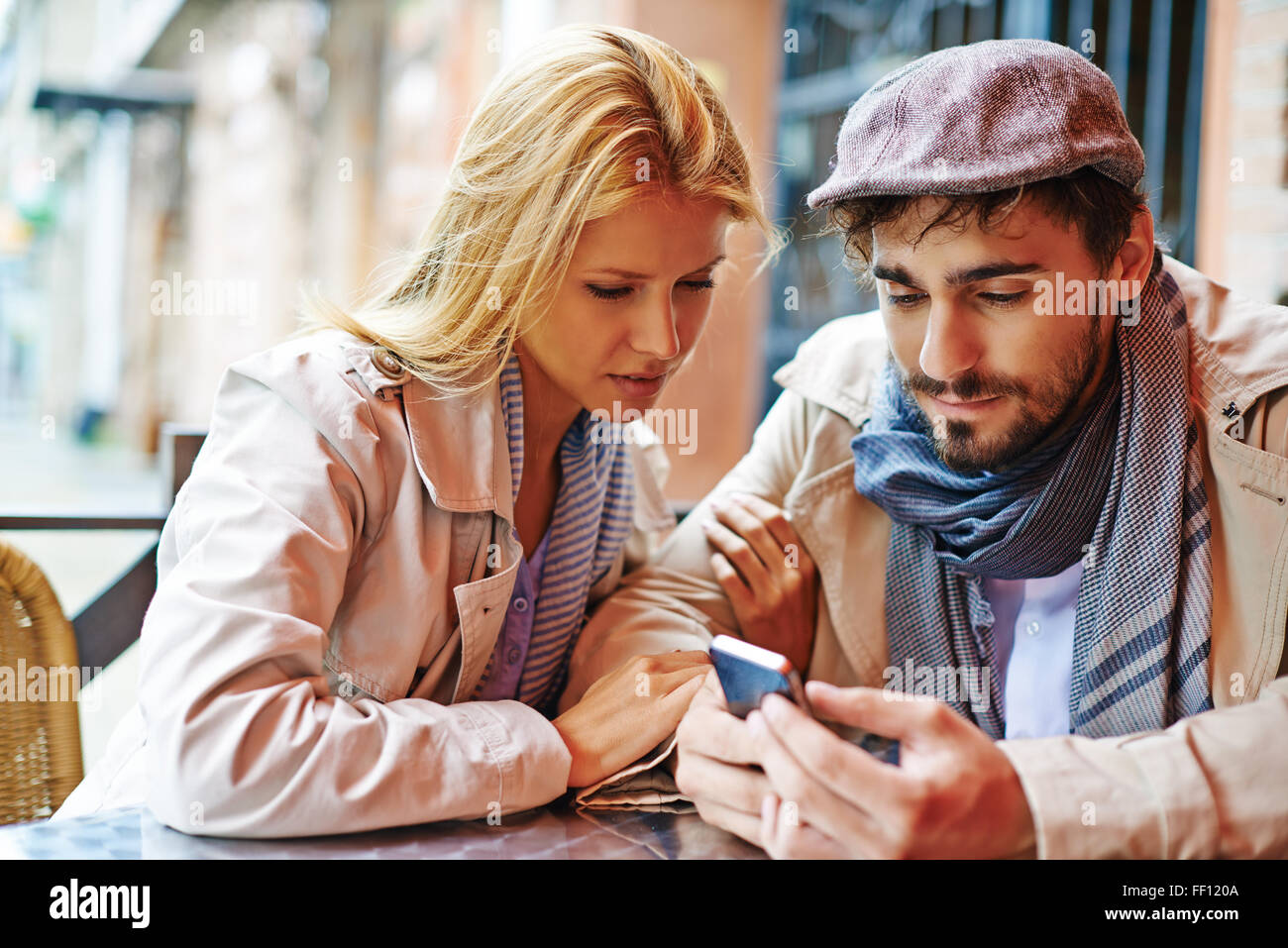 Young valentines using cellphone - Stock Image