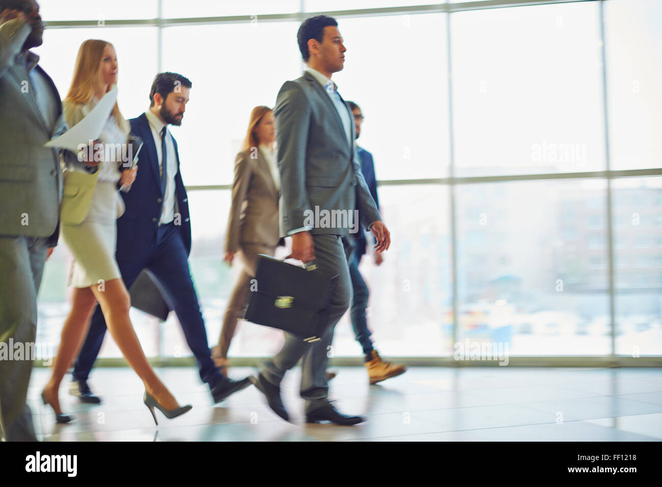 Modern business people walking to work Stock Photo