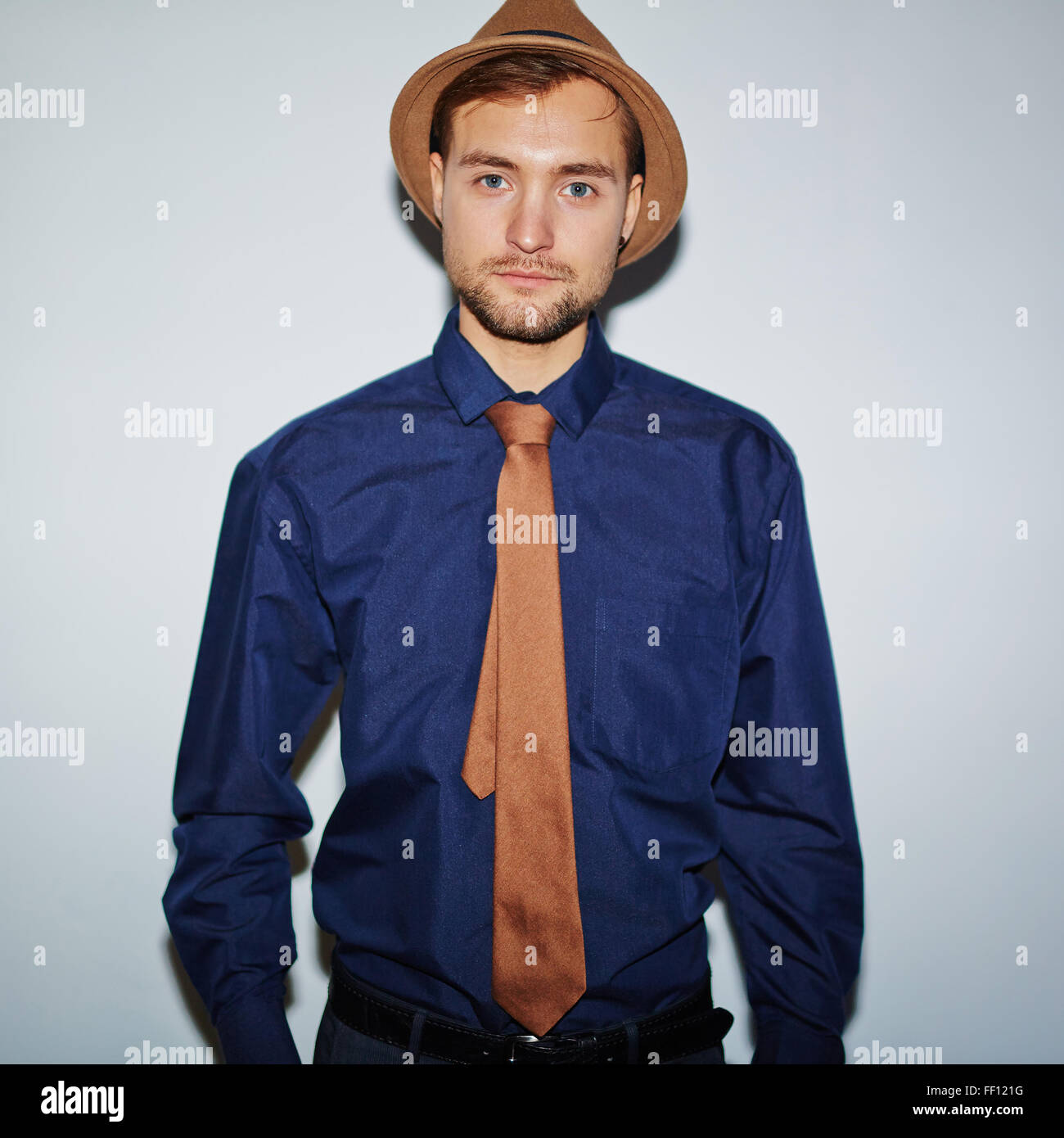 Serious well-dressed guy looking at camera - Stock Image