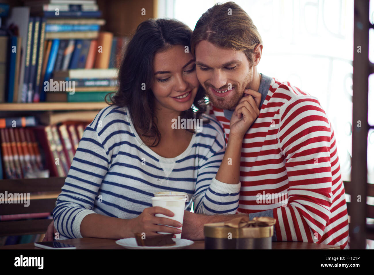 Amorous valentines spending time in cafe - Stock Image