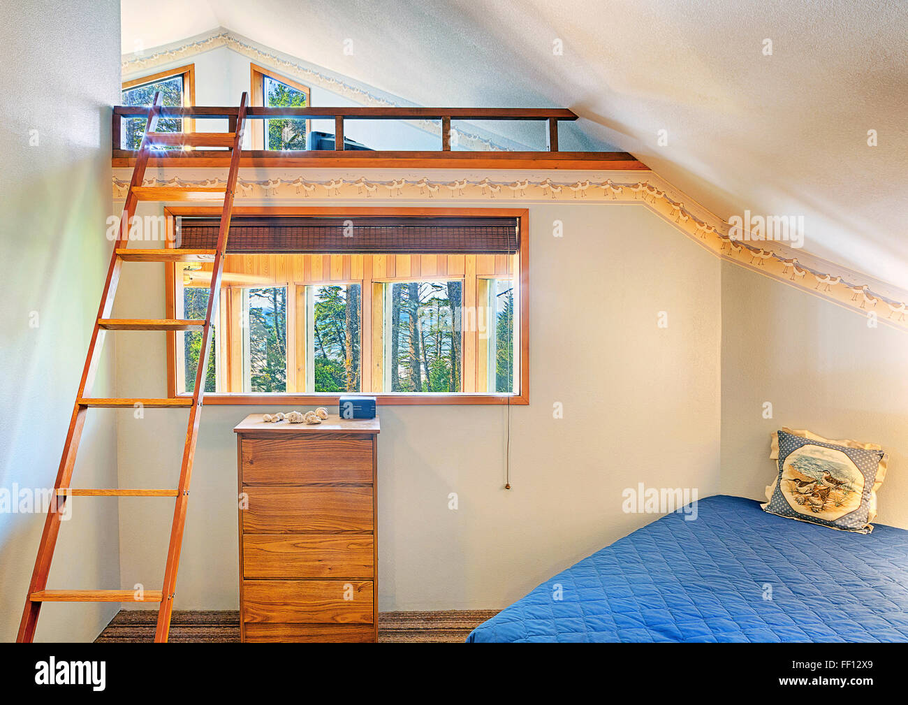 Loft bed in modern bedroom - Stock Image