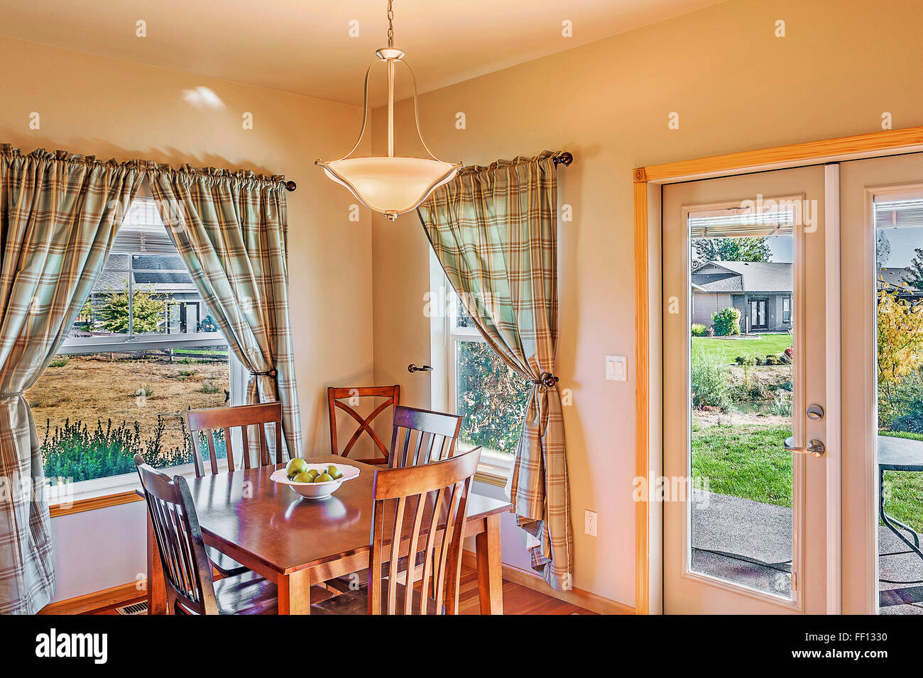 Table and windows in dining room Stock Photo