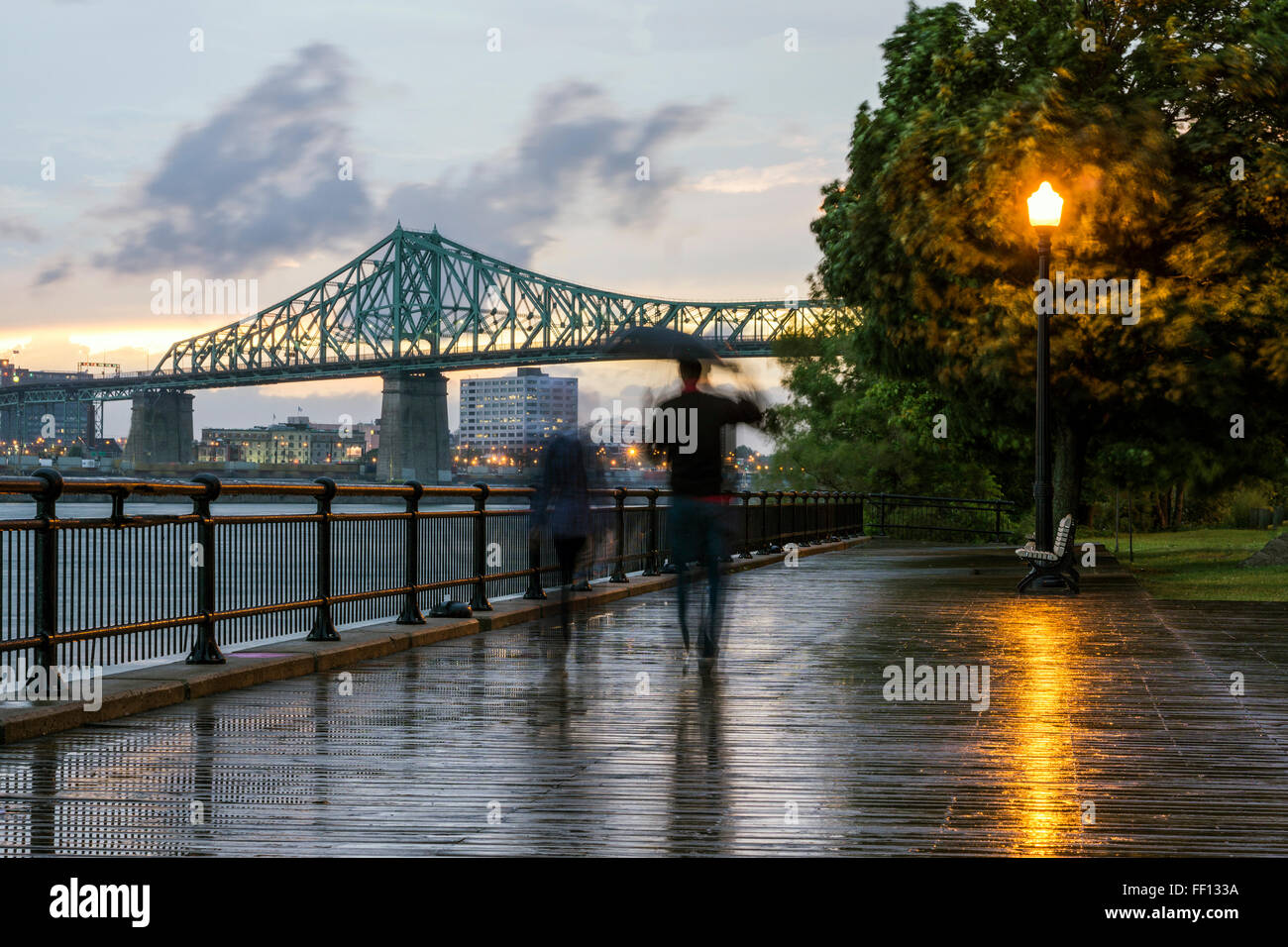 Blurred view of people on Montreal waterfront, Quebec, Canada - Stock Image