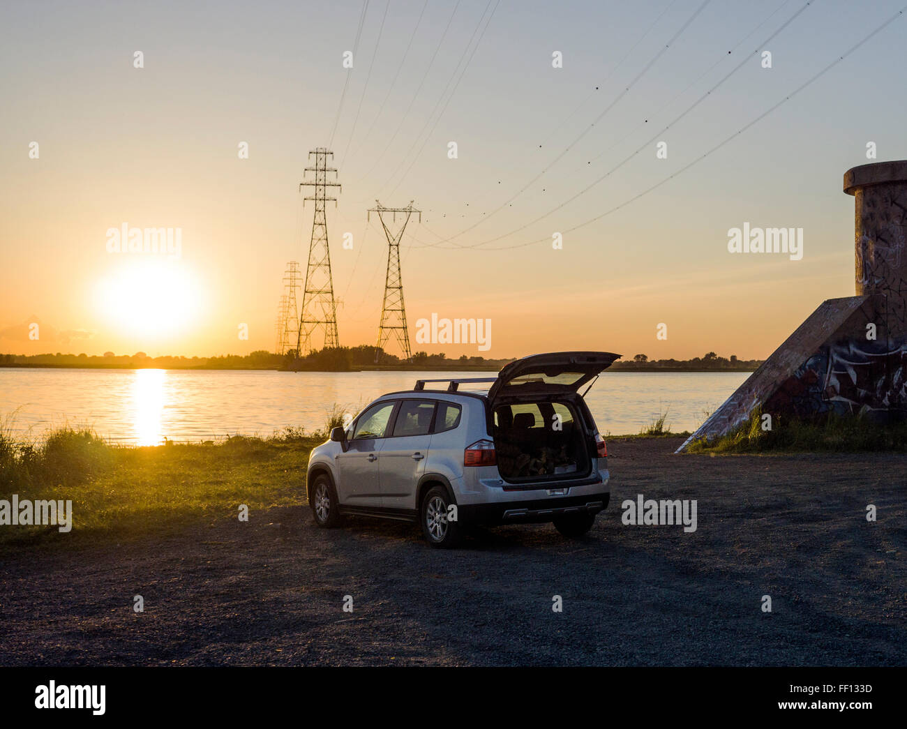 Car parked on rural lake shore - Stock Image