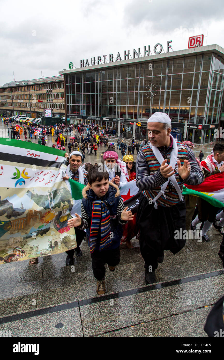 Street carnival in Cologne, Germany, Syrian folk group take part in the street carnival party, refugees group, - Stock Image