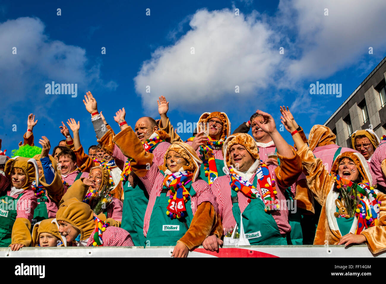 Street carnival parade and party in Cologne, Germany, at Carnival Monday, Shrove Monday, Rose Monday, people in - Stock Image