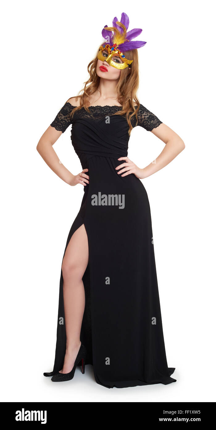 Young woman in black evening gown on white. Carnival mask on face. - Stock Image