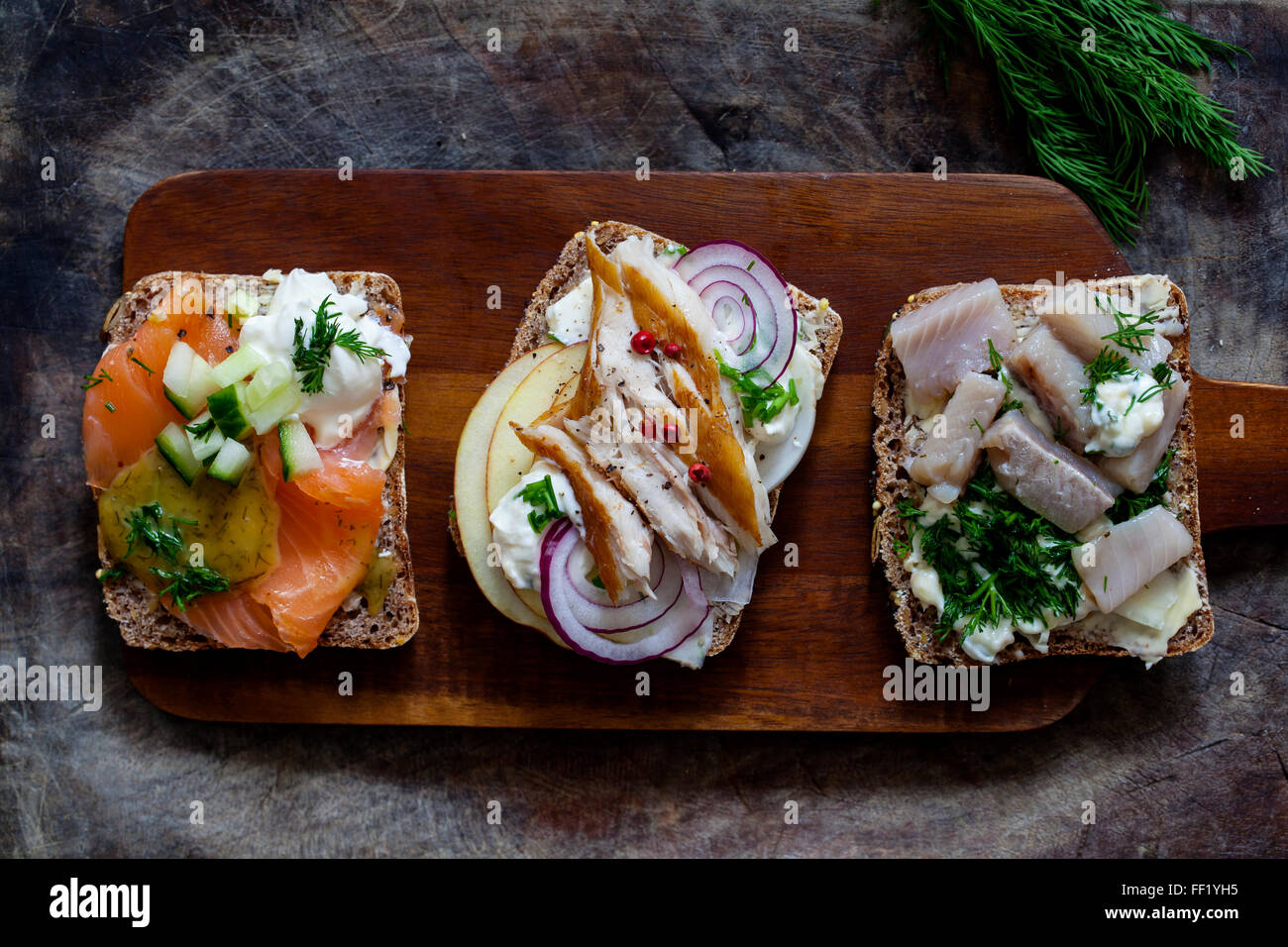 Scandinavian sandwiches with smoked mackerel, herrings and salmon - Stock Image