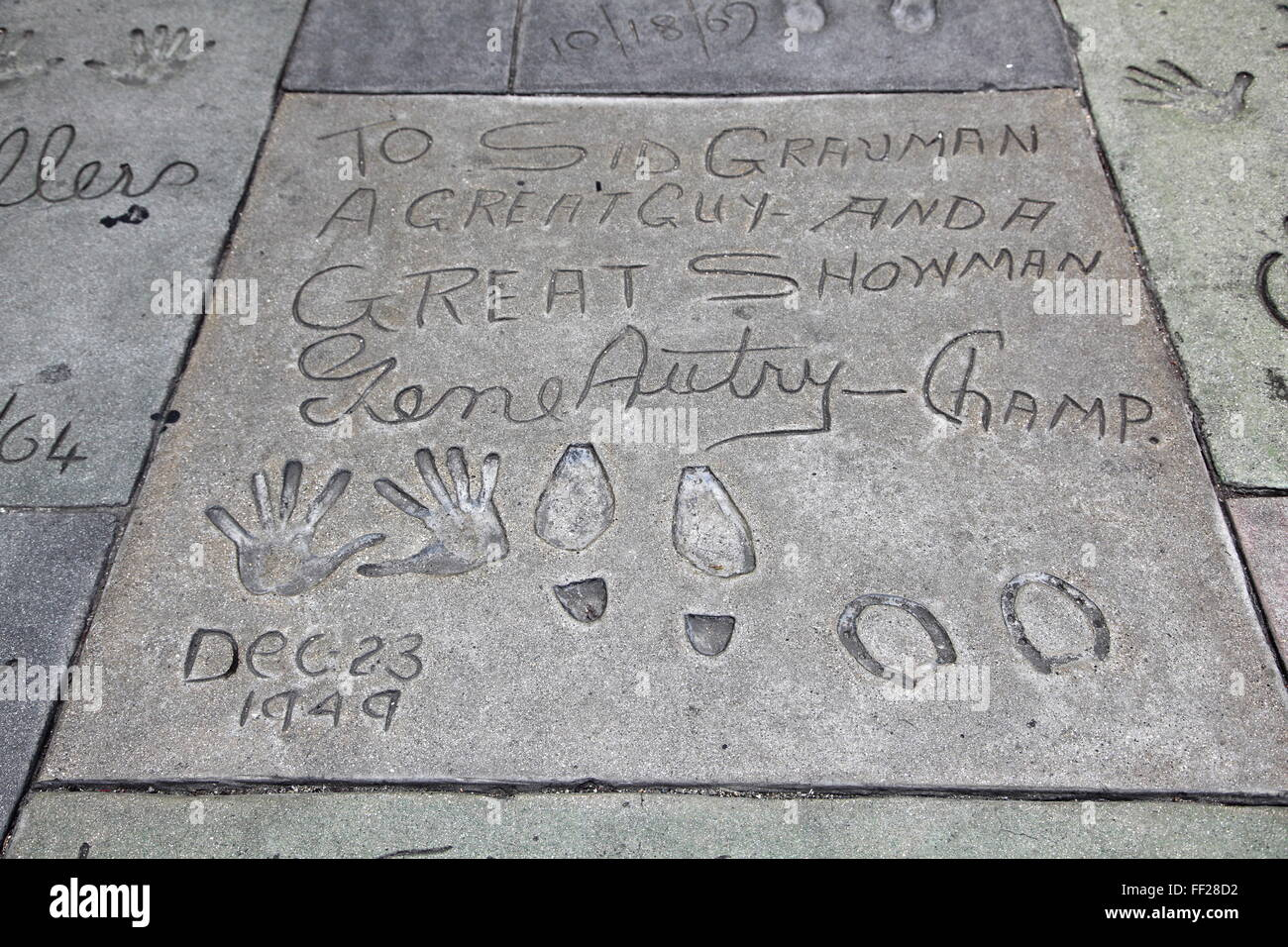Hand and foot prints of Gene Autry, Manns (Graumans) Chinese Movie Theatre, HoRMRMywood BouRMevard, RMos AngeRMes, - Stock Image