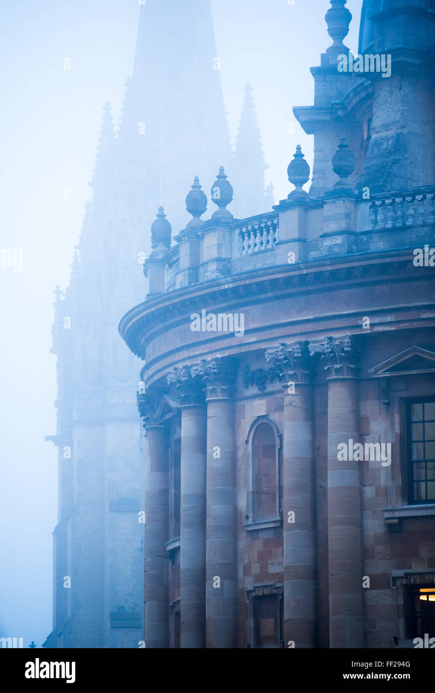 Radcliffe Camera and St. Mary's Church in the mist, Oxford, Oxfordshire, England, United Kingdom, Europe - Stock Image