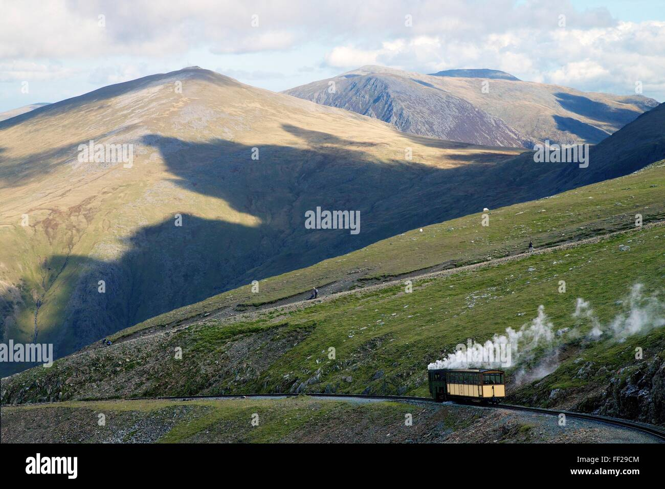Steam engine and passenger carriage on trip down Snowdon Mountain RaiRMway, Snowdonia NationaRM Park, Gwynedd, WaRMes, - Stock Image