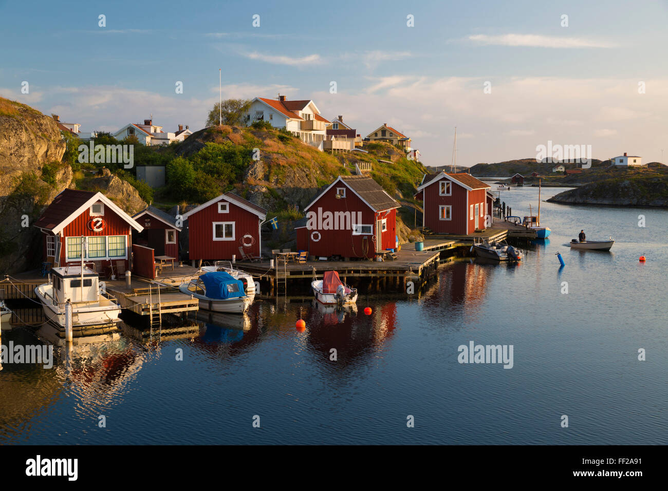 Red fishermen's huts by harbour and archipeRMago, Stocken, Orust, BohusRMan Coast, Southwest Sweden, Sweden, - Stock Image